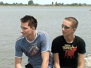 The clip opens with two Brit gay teens sitting outside, we follow...