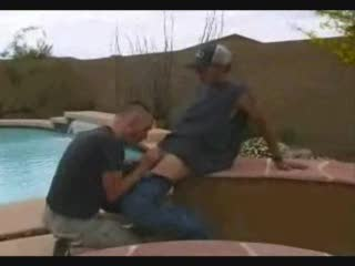 Gay sucking of a big cock outdoors